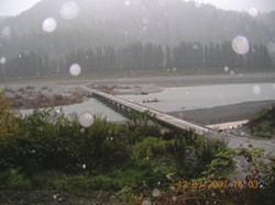 PHOTO BY BILL WHITE, SOUTHERN HUMBOLDT COUNTY ROADS AND BOAT CREW SUPERVISOR. - The rain is coming down but the river is still far below the McCann Road bridge.