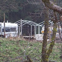 Titlow Hill Blues The St. Johns say their neighborhood is filling up with junky encampments and non-permitted structures and roads. Photo by Heidi Walters