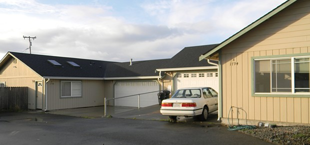 These two units, joined by a garage wall, became the site of discord after the family in front complained that the occupants in back were running a marijuana grow. The opaqued garage windows on the back unit were one of the first clues, the neighbors said - PHOTO BY CARRIE PEYTON DAHLBERG