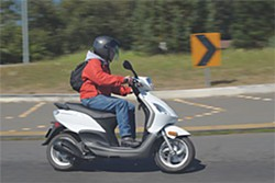 Tim Patton negotiates a curve on the round about just east of Highway 101 on Old Arcata Road. Patton recently purchased a Piaggio Fly 150 made by Vespa to  commute from his home in Eureka to his cabinetry business on West End Road. Photo by Mark McKenna