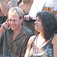 Backstage Pass Tom Dimmick and Carol Bruno at Reggae Rising. Photo by Bob Doran .