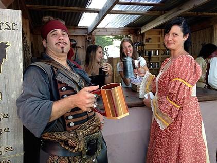 Tossing back a tankard at the Dark Horse Tavern. - JENNIFER FUMIKO CAHILL
