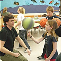 Send Out The Clowns Trillian Hammons spins a ball with Patrick Maguire at Sunny Brae Roadrunners after school program. Kodi Patterson looks on. Photo by Bob Doran.