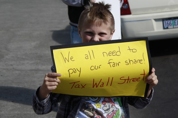 Truth Jackson, 9, of Eureka holds a sign outside the courthouse on Saturday. He goes to Washington Elementary School, and was attending the protest with his mom. - PHOTO BY ZACH ST. GEORGE