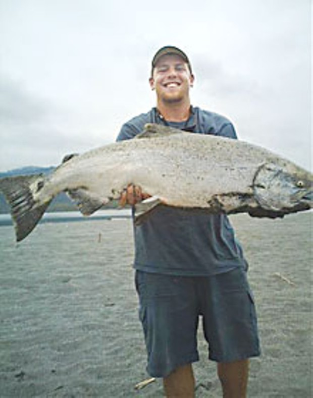 Tyler Duncan shows off his giant catch. The salmon weighed an estimated 40 pounds, and Duncan gave the prize catch to Native Americans fishing nearby that day. Photo courtesy Rich Denaio.