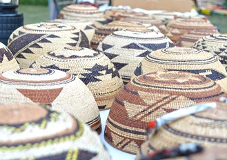 Traditional Hupa woven hats. - PHOTO BY CUTCHA RISLING BALDY