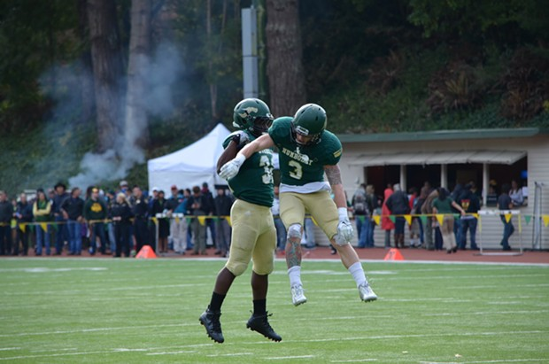 Wide receiver Chase Krivashei and tailback Ja'Quan Gardner celebrate a touchdown in 2015. - FILE