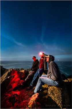 High over the Pacific, the three of us held still for 15 seconds to pose for this portrait at the edge of the continent. That's Jupiter above my head. - DAVID WILSON