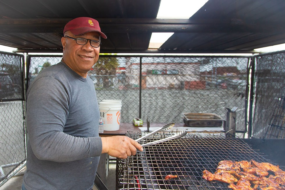 Sammy's dad at the grill. - AMY KUMLER