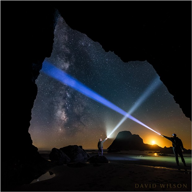At one point while photographing, my brother and I played with our light beams beneath the cosmos, careful not to cross the streams. We tried one take on this, and by luck our beams formed a little house over the setting moon and Camel Rock. - DAVID WILSON
