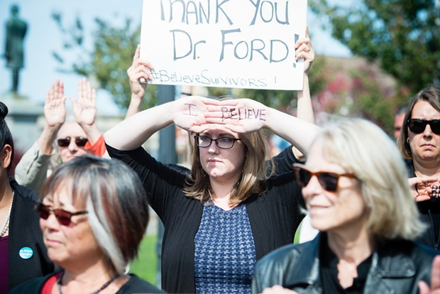 Protesters gathered on the Arcata Plaza in support of Christine Blasey Ford. - PHOTO BY MARK MCKENNA
