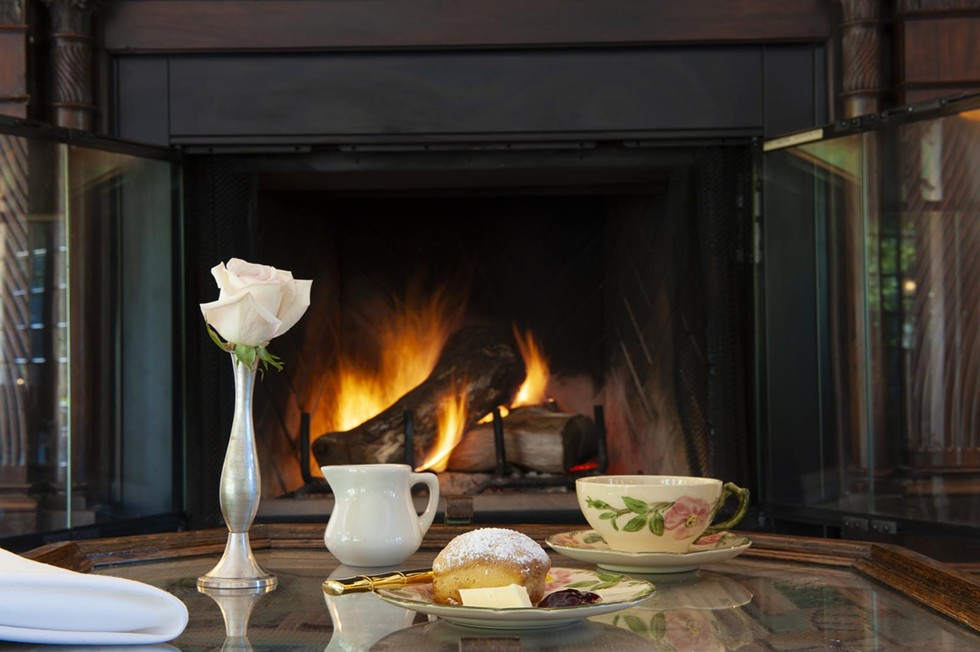 Afternoon tea in front of the fireplace. Courtesy of Benbow Historical Inn.