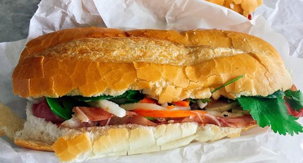 The bành mí (aka khao chī) sandwich you can only get on Saturdays — if you're quick. - PHOTO BY JENNIFER FUMIKO CAHILL