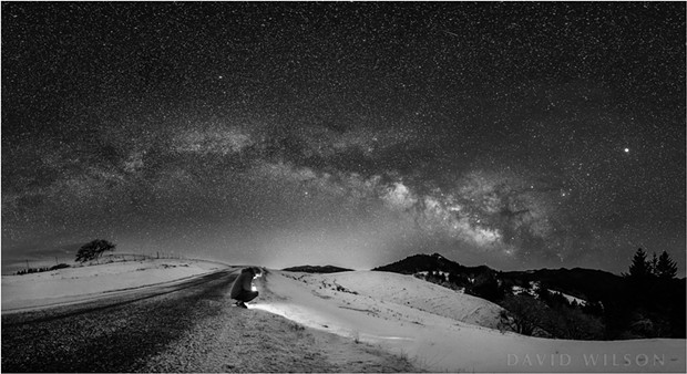 Self-portrait beneath the arc of the Milky Way. - DAVID WILSON