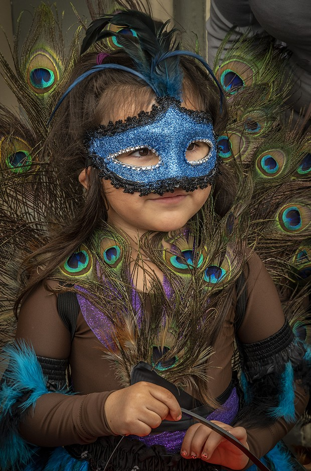 This young girl rocked maximum plumage with her beautiful peacock costume. - PHOTO BY MARK LARSON