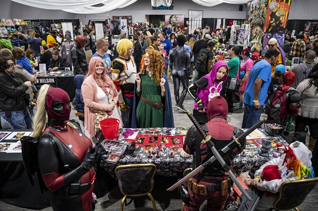 A large crowd of attendees wandered through a mix of vendors and featured artists at Ohana Comic Con. - PHOTO BY MARK LARSON