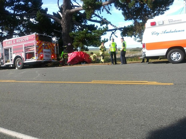 Emergency crews at the scene of the Loleta crash. The car is wrapped in a red tarp. - BOBBY KROEKER