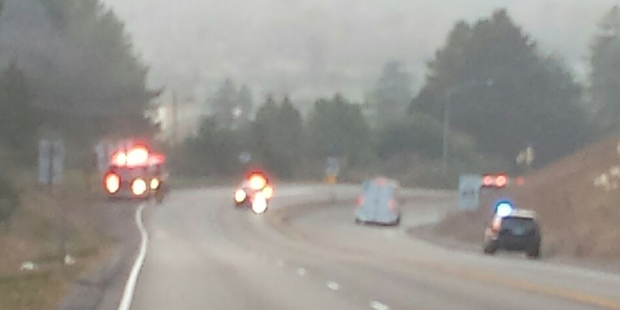 Fire engines and law enforcement along Hwy 299 at a fire that is now under control. - PHOTO COURTESY OF MARK NELSON