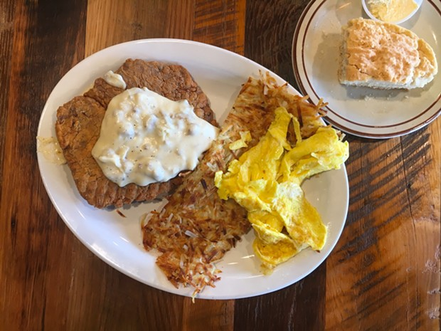 Chicken fried steak with hash browns, scrambled eggs and a biscuit. - PHOTO BY JENNIFER FUMIKO CAHILL