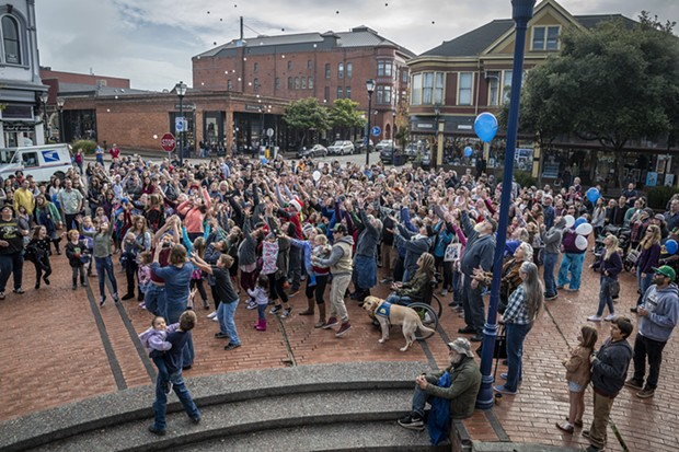 The crowd gets ready to catch prize ping-pong balls shot into the air over the gazebo in Old Town. - PHOTO BY MARK LARSON
