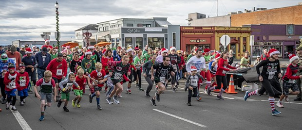 And they're off! The third annual Ugly Holiday Sweater Run. - PHOTO BY MARK LARSON