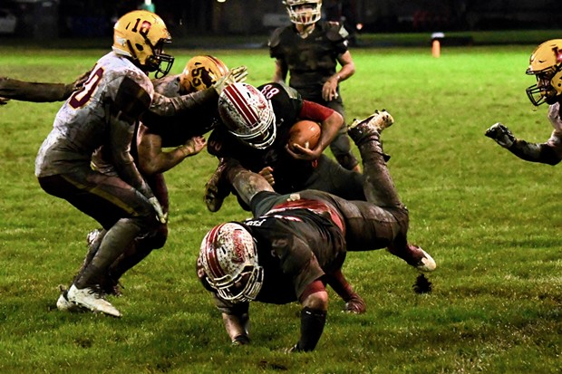 A rain-soaked Eureka Logger crowd at Albee Stadium celebrated a mud splattered victory Saturday night over previously unbeaten Las Lomas, 21-0, in the semifinal round of the North Coast Section D-III playoffs. - JOSE QUEZADA