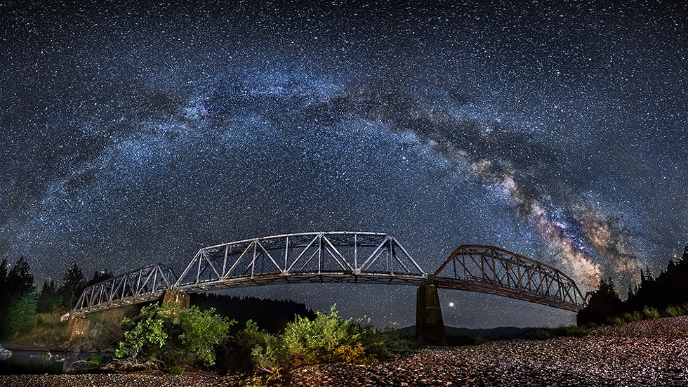 The South Fork Bridge, or Dyerville Trestle, of the Northwestern Pacific Railroad crosses the main Fork Eel River beneath the Milky Way, just north of the confluence with the South Fork Eel River. July of 2018. - PHOTO B Y DAVID WILSON