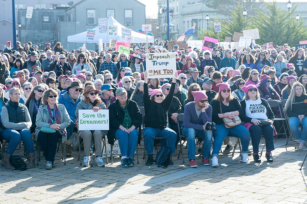 Demonstrators gather at the foot of C Street in Eureka to listen to speakers before the 2018 Women's March. - PHOTO BY MARK MCKENNA