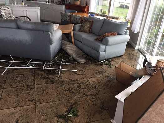 Broken door, soaked furniture and debris on the floor mar this beautiful beachfront home. - CHERYL ANTONY OF SHELTER COVE FIRE