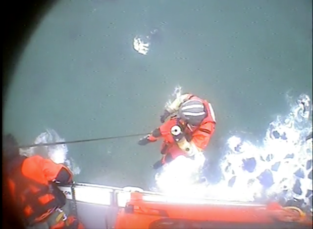 A rescue swimmer is lowered down 250 feet to a stranded hiker in this file photo. - U.S. COAST GUARD