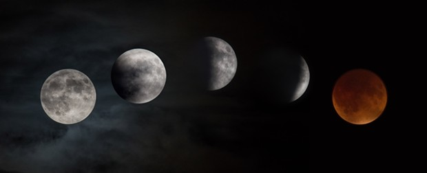 The supermoon lunar eclipse captured as it moved over NASA's Glenn Research Center on Sept. 27, 2015. - NASA/RAMI DAUD