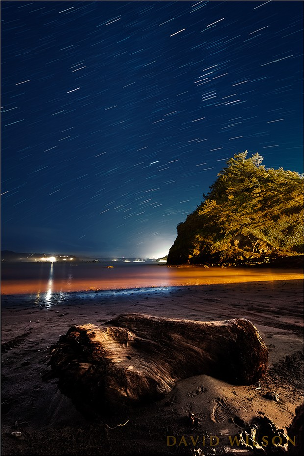 The stars arc across the sky in their nightly parade in this view looking south from Boat Launch Beach, or Indian Beach, beneath the town of Trinidad. Jan. 30, 2019. - PHOTO BY DAVID WILSON