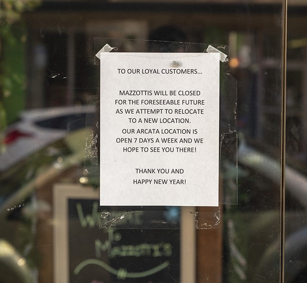 The sign on the glass door of Mazzotti's in Eureka. - PHOTO BY ZACH LATHOURIS