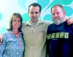 Jeffrey Jurgens at Atascadero State Hospital a couple of years ago, surrounded by his parents. - FAMILY PHOTO VIA JOANNA JURGENS