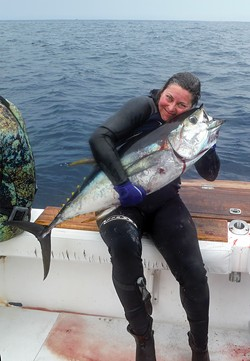 Brandi Easter and her freshly speared yellowfin tuna in Panama in April of 2017. - COURTESY OF BRANDI EASTER