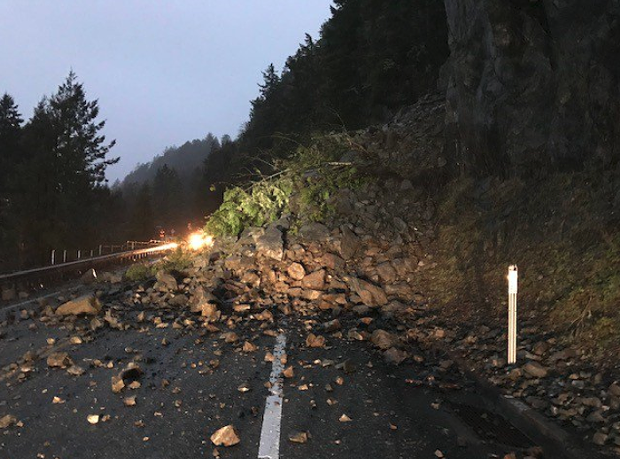 A slide left boulders and trees covering U.S. Highway 101 last night. - CALTRANS