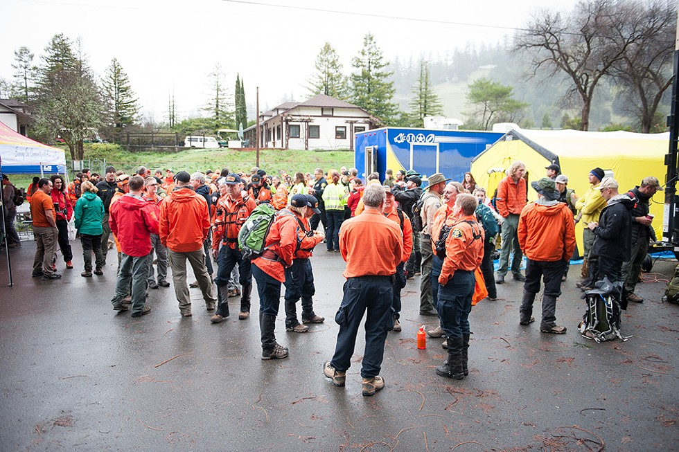 Search teams from across Northern California gathered for the morning briefing on March 3. - PHOTO BY MARK MCKENNA