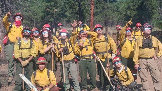 Benito Nuñez-Rodriguez (lower left) with his firefighting unit. - SUBMITTED
