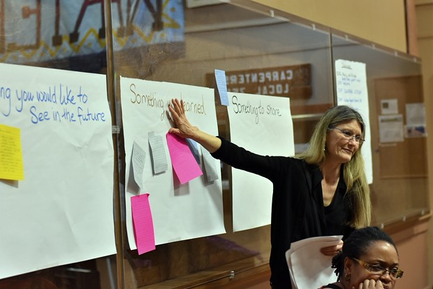 Editor of the Humboldt Historian Suzanne Forsyth places her feedback about what she learned on a poster board at the Womxn's Conference March 9 in the Labor Temple - PHOTO BY MEGAN BENDER