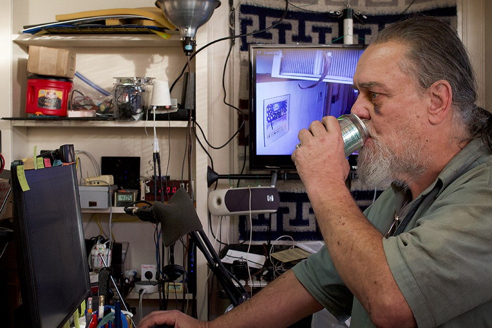 """Self-described """"digital nomad"""" Robert Stretton works on his pirate radio station in the last place he resided, a fifth floor office building in Eureka from which he was ultimately evicted. - PHOTO BY T.WILLIAM WALLIN"""