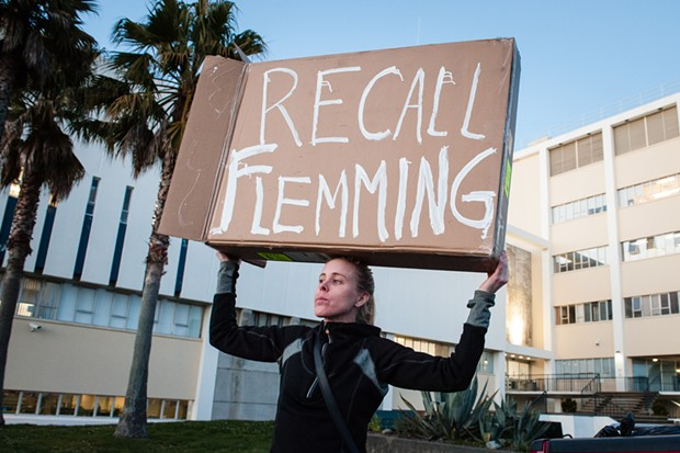 Aunna Bowllmann holds a sign in front of the Humboldt County Courthouse yesterday, protesting a criminal grand jury's decision not to indict anyone in the unsolved killing of David Josiah Lawson. - MARK MCKENNA