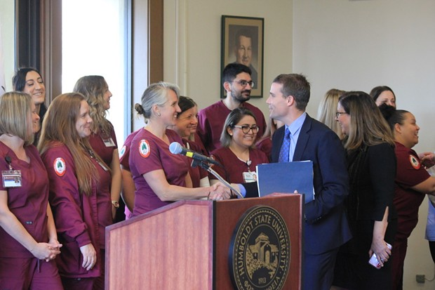 North Coast state Sen. Mike McGuire with future students of Humboldt State University's bridge nursing program. - FREDDY BREWSTER