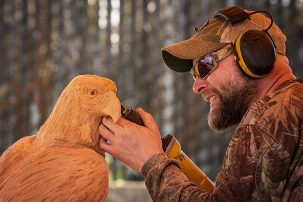 Jason Stoner, of Fairfield, Pennsylvania, etched the finishing touches on this old-growth redwood eagle during the conference. - PHOTO BY MARK LARSON