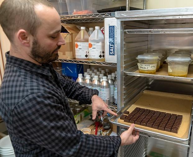 Jonah Ginsberg in the Humboldt Chocolate Bites kitchen. - PHOTO BY ZACH LATHOURIS