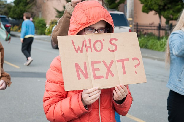 """Sunny Brae Middle School Student Nova Vaur held a sign asking, """"Who's next?"""" at Saturday's March for Our Lives in Arcata. - PHOTO BY MARK MCKENNA"""
