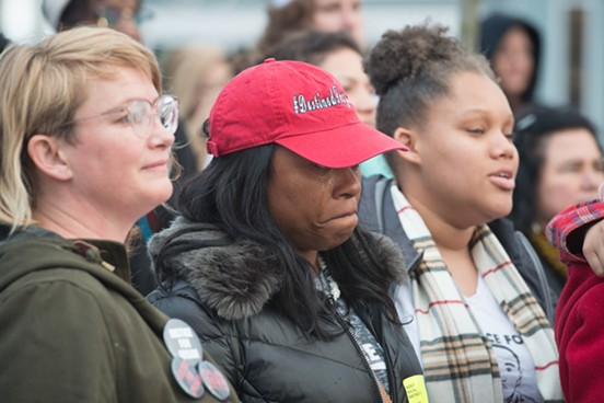 """Charmaine Lawson chokes back tears as Bob Marley's """"One Love"""" is sung in honor of her son. - MARK MCKENNA"""