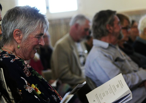 Jane Riggan sits with family as she remembers Bill Thompson at his memorial on Friday. - PHOTO BY NATALYA ESTRADA