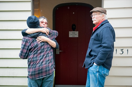 Danielle Orr, a 39-year volunteer at KHSU, hugs intern Damian Jimenez outside the station's office in the Feuerwerker House. Jimenez is a communications major and journalism minor who said KHSU was one of the things that drew them to Humboldt State University. - MARK MCKENNA