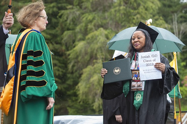 Charmaine Lawson accepts an honorary degree on behalf of her son, David Josiah Lawson, who was fatally stabbed in 2017 while a sophomore at Humboldt State University. - MARK MCKENNA
