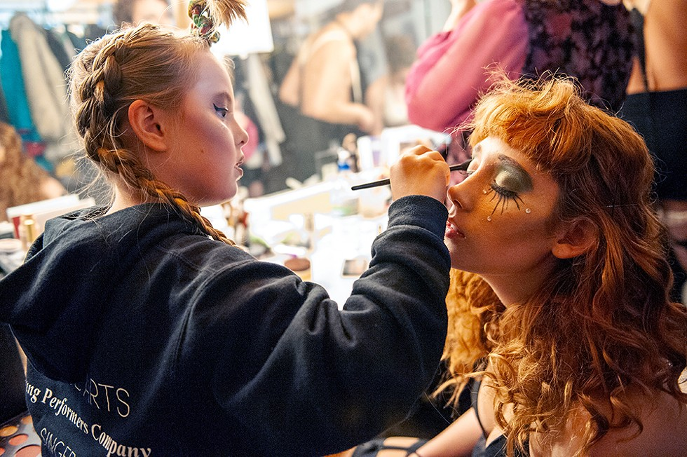 Ten-year-old Lily Herlihy helps Maggie Hockaday with her makeup. - PHOTO BY MARK MCKENNA